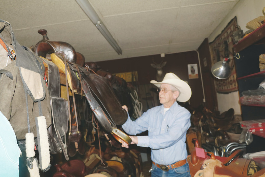 Tom Knowles talks about one of the saddles he has in his collection that is located in his business, The Wildflower Saddles and Tack Shop in Elizabeth. Knowles restores and repairs saddled and he oer the years he has assembled collection that includes some fairly modern saddles as well as some that date back to the 1800s.