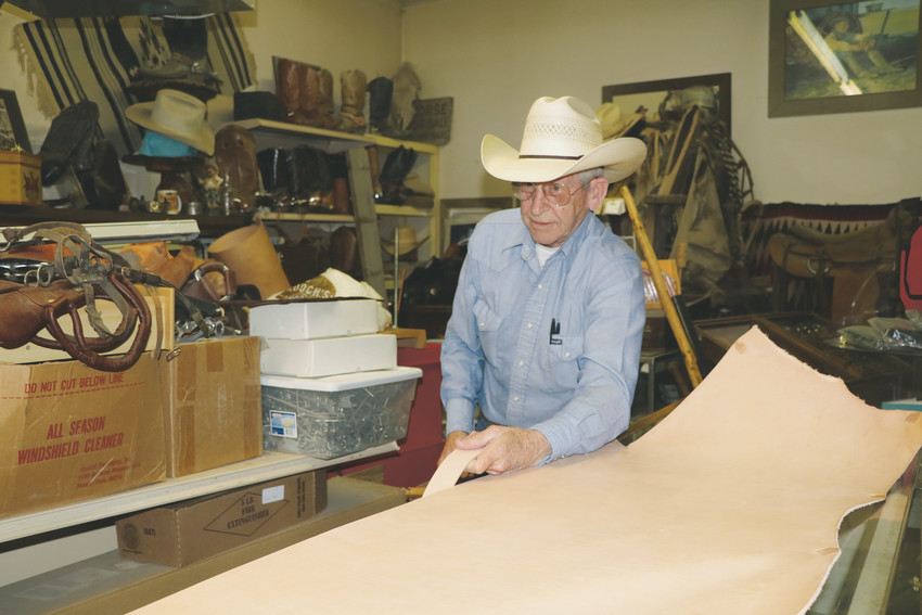 Owner Tom Knowles uses tools to make the reins used to control a horse in The Wildflower Saddles and Tack Shop at 122 Main Street in Elizabeth. Knowles, 71, worked cattle from a young age and said he still occasionally gets in the saddle to help a local rancher during roundup.