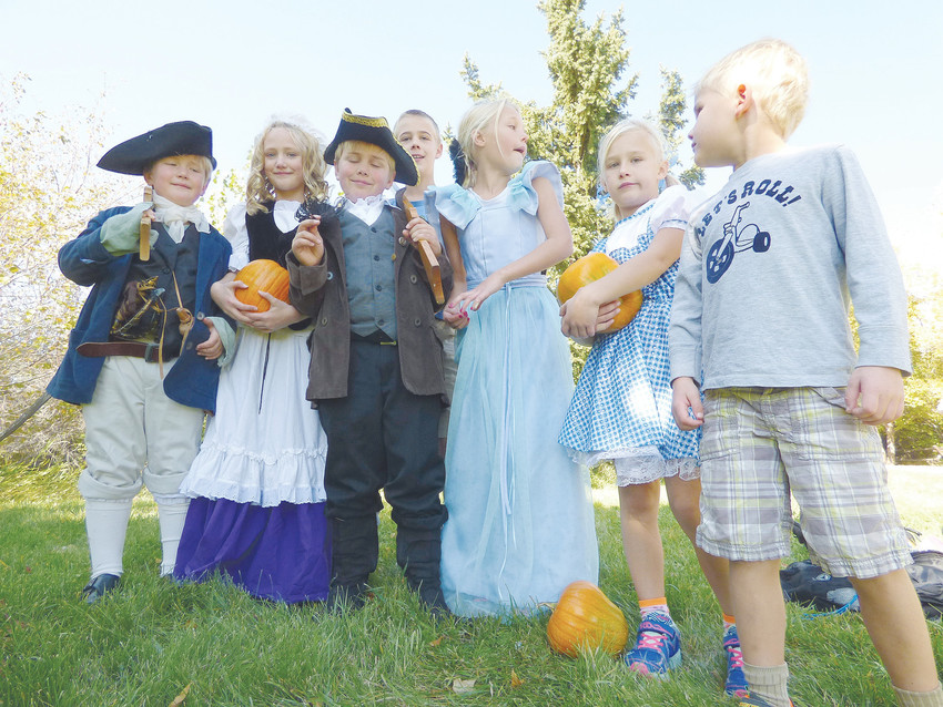 Dressing for success: Trying out their Halloween costumes, from left, Hunter Ayres as Paul Revere, Sophia Ayres as Abigail Adams, Liam Ayres as John Hancock, Ridge Goldie, who plans to go as a scientist, Auden Goldie as Queen Isabella, Merit Goldie as Dorothy from the Wizard of Oz, and Hutch Goldie, who doesn't know what he wants to go as yet.
