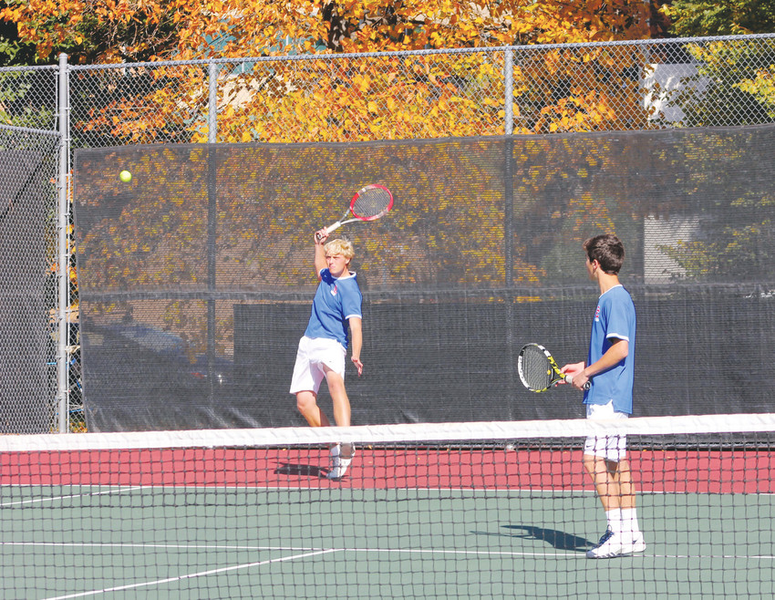 Cherry Creek's Tyler Schoen returns a serve as his No. 4 doubles parter Devin Brownstein watches during the Oct. 14 championship match of the Class 5A state tennis tournament at the Gates Tennis Center in Denver. Schoen and Brownstein defeated Matthew Mahoney and James O'Connor of Regis Jesuit, 6-7, 6-4, 6-0, which gave the Bruins the points needed to edge Regis for second place in the team standings.