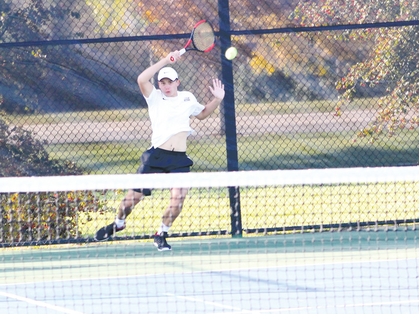Ponderosa senior Ryan Neale retreats to return a shot against Mountain Range's Javier Valenzuela in the third-place match on Oct. 14 at the Class 5A state tennis tournament at the Gates Tennis Center. Neale won 6-2, 6-1.