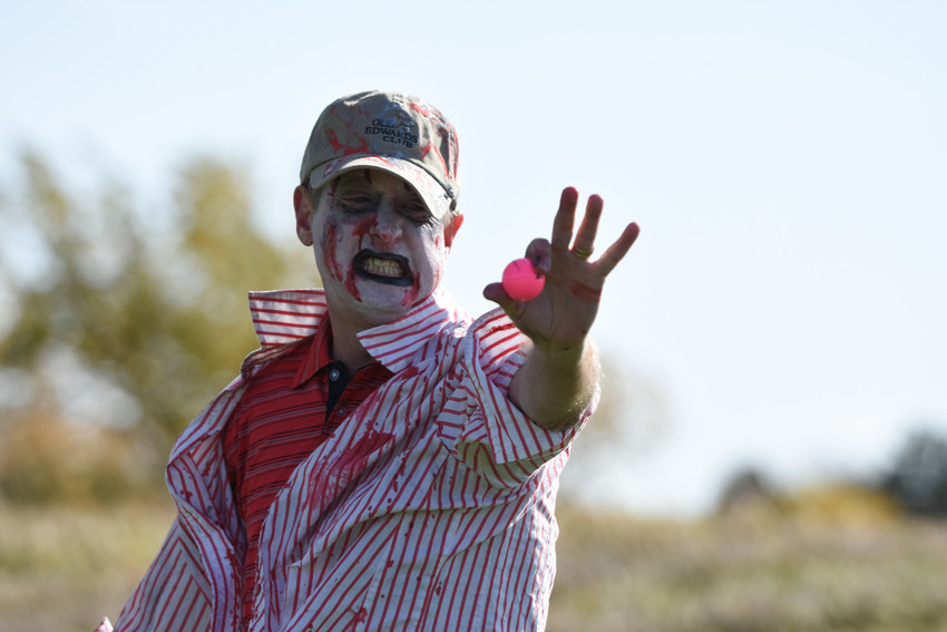 """Zombie"" Gordon Tewell of Arvada, proudly displays a golf ball he confiscated during Westminster's second annual Zombie Apocalypse Golf Tournament."