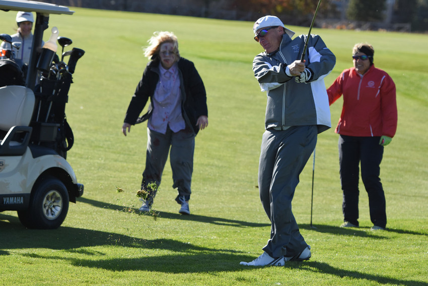 As if the wind wasn't bad enough, area golfers had to dodge zombies on each hole as part of the city's second Annual Zombie Apocalypse Golf Tournament. Winds gusted at nearly 60 m.p.h., making conditions difficult for all participants.