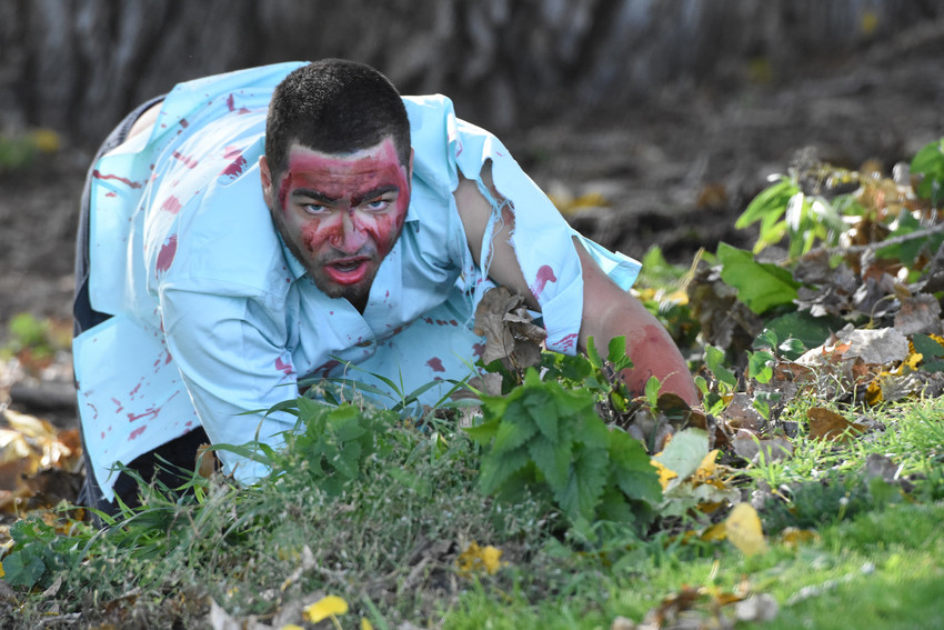 """Zombie"" A.J. Ehrhardt of Westminster, lurks on the 13th hole, during the second annual Westminster Zombie Apocalypse Golf Tournament at Legacy Ridge Golf Club. Players and zombies endured severe wind and cold during the best ball scramble."