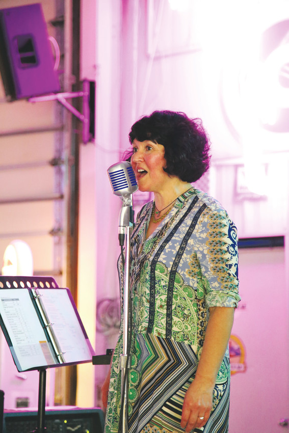Tamra McIlvain, of Half Pint and Growlers, sings at the Stouts and Stories event held at the Lamar Center Oct. 11.