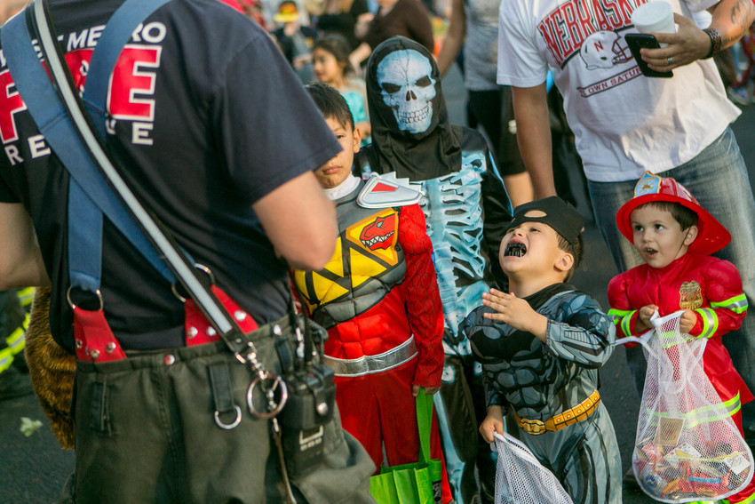 Firefighters take part in Wheat Ridge's annual trunk or treat.