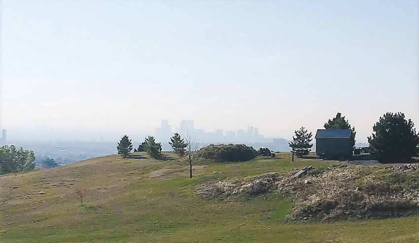 Denver's skyline peeks out from behind the haze Oct. 13 as seen from 82nd and Lowell Boulevard in Westminster. Air quality along Colorado's Front Range is improving, according to health officials, but there are still days when pollution here is a concern.