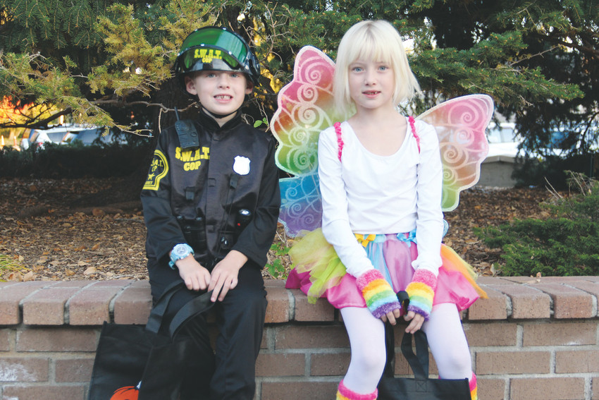 Braydyn Johnston, 5, and 7-year-old Mackenzie Johnston, right, in Halloween costumes outside the Goodson Recreation Center in Centennial at the city-sponsored Spooktacular event Oct. 13. Kids trick-or-treated in the gym at several stations where they completed an activity like a hoop-toss before picking candy.
