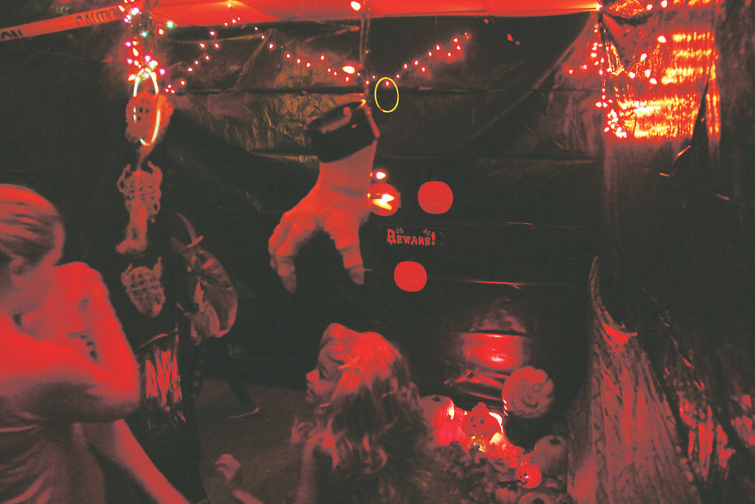Parents and children walk through the haunted house section of the Spooktacular at Goodson Recreation Center Oct. 13. Lined with eerie lights and decorations, it opened up at the end to a room with face-painting and caramel apples.