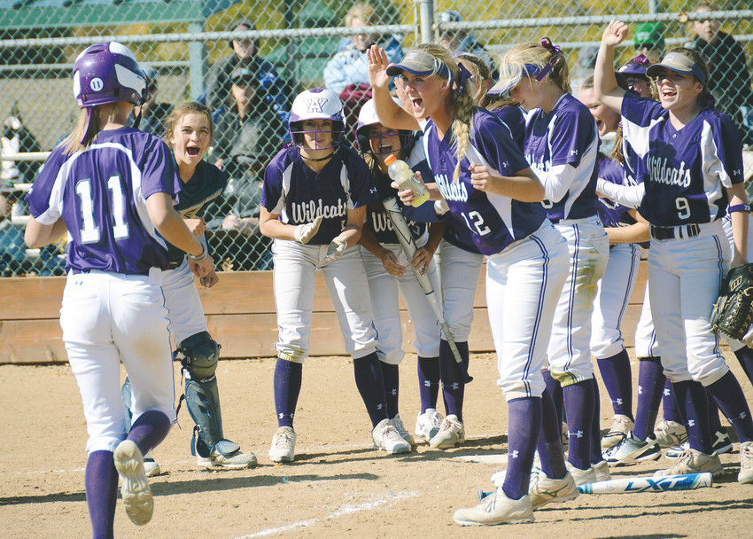 Arvada West catcher Shelby Robb, right, reaches to grab the ball as ThunderRidge's Hannah Stanley slides into home plate Oct. 14 at Youth Memorial Park. A-West defeated Pine Creek and ThunderRidge in the Class 5A Region 5 tournament to advance to the state tournament this week.