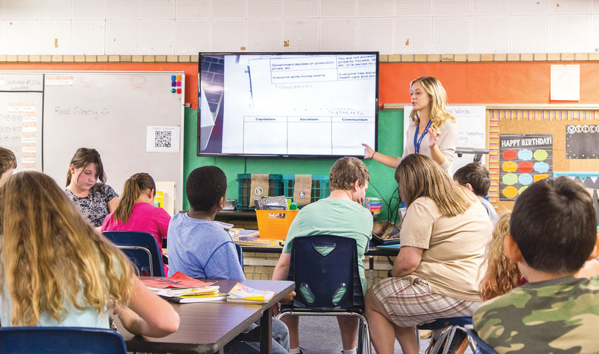 Molly McTaggart teaches her fifth-grade class at Cherrelyn Elementary in Englewood. Teachers in Englewood Schools are trained in Mental Health First Aid as a way to develop students' social and emotional learning skills.