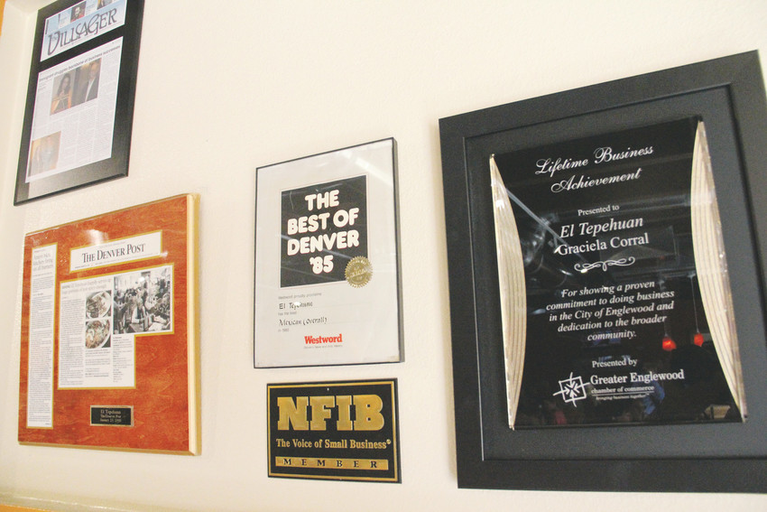 Newspaper articles and accolades displayed on the wall at El Tepehuan Oct. 16. Included are stories from The Denver Post and The Villager, along with an award from Westword magazine and an achievement award from the Greater Englewood Chamber of Commerce.
