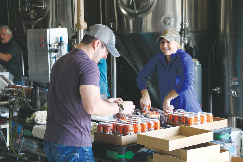 Employees at Arvada's Odyssey Beerwerks work on canning beer on an autumn morning. The brewery won its first Great American Beer Festival medal at this year's event, held Oct. 5-7.