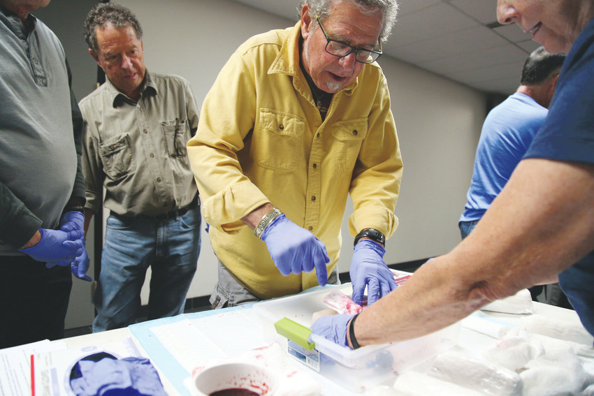 Community members practiced packing wounds at the Stop the Bleed class held at the Arvada Fire Training Center.