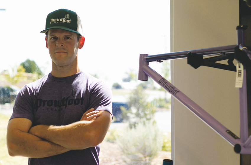 Jon Acuff stands by one of his steel bicycle frames at the Proudfoot retail space in Golden, Colo. The company prides itself on building steel bikes made to perform.