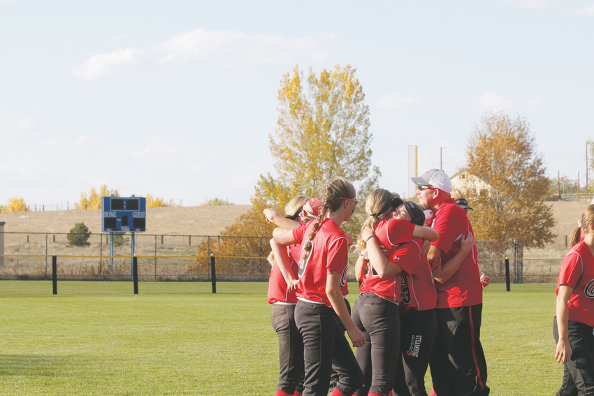 Elizabeth players and coaches exchange hugs and a few tears were shed on Oct. 20 as the Cardinals season came to an end in quarterfinals of the state Class 4A State Softball Tournament played at Aurora Sports Park. Elizabeth finished with an 18-6 record which included going undefeated in six games to win the league title, advancing to state, defeating No. 2 seeded Golden in the first round before losing to Mullen in the quarterfinals.