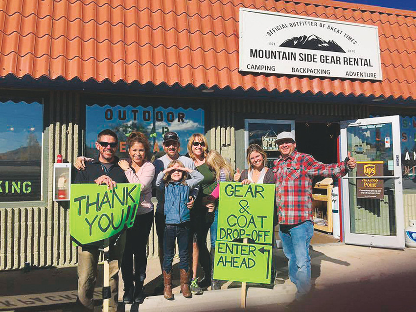 Organizers of Mountain Side Gear Rental's inaugural Share the Warmth Gear and Coat Drive pose for a photo op during the event on Oct. 21.