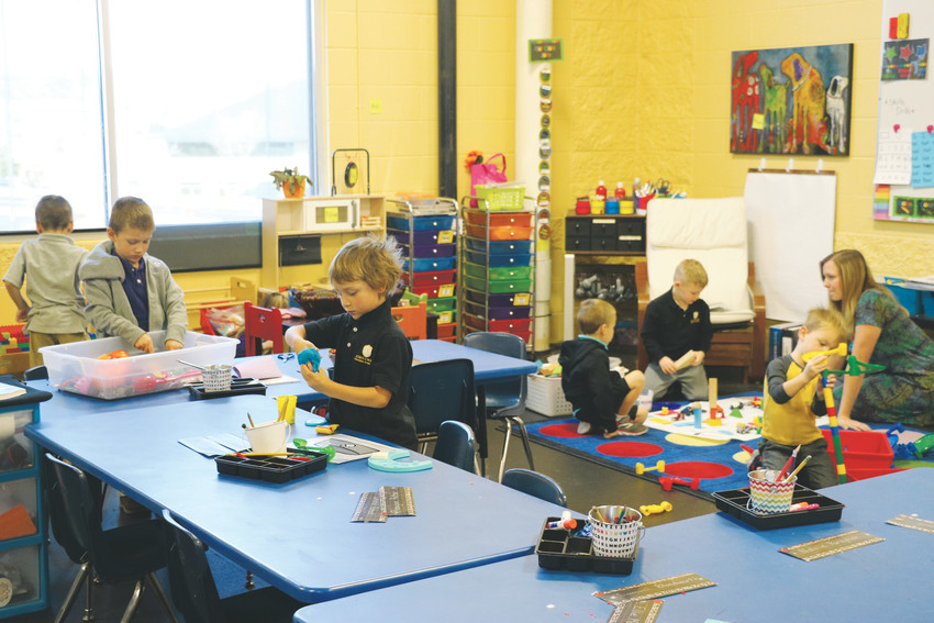 Wearing uniforms, kindergarten students keep busy with building blocks and playdough at Kingsway Academy, a private Christian School that opened in September at 4760 Castleton Way in Castle Rock.