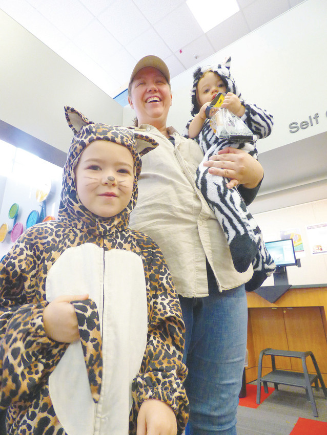 Darci Jones, center, plays zookeeper to her little animals: 5-year-old Natalie Jones, left, and 1-year-old Seth Jones, right.