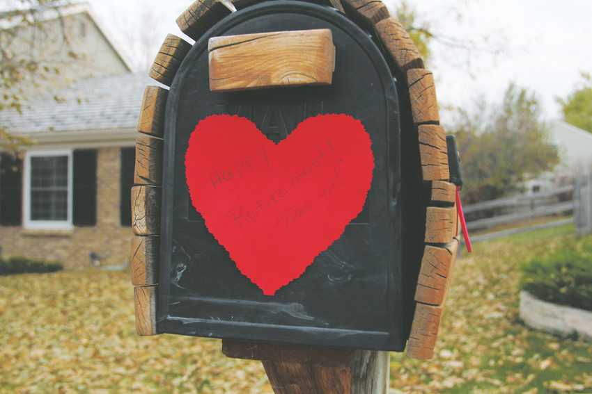 "A paper heart that reads ""Happy retirement! Thank you!"" lines Ellen Nelson's mail delivery route in Homestead Farms in Centennial Oct. 27. Neighbors put the hearts on mailboxes and threw Nelson a surprise celebration on her last day."