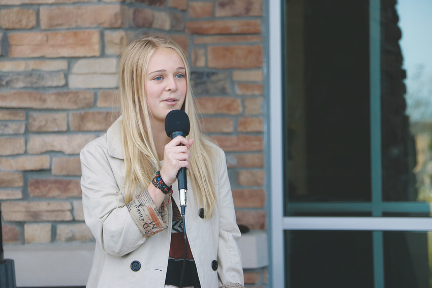 "Quinn Hunchar, an 18-year-old student of Eagle Academy, speaks at the grand opening of Douglas County Opportunities Center Oct. 24. ""This place is an opportunity for people who didn't fit that mold to grow and learn and better themselves,"" Hunchar said."