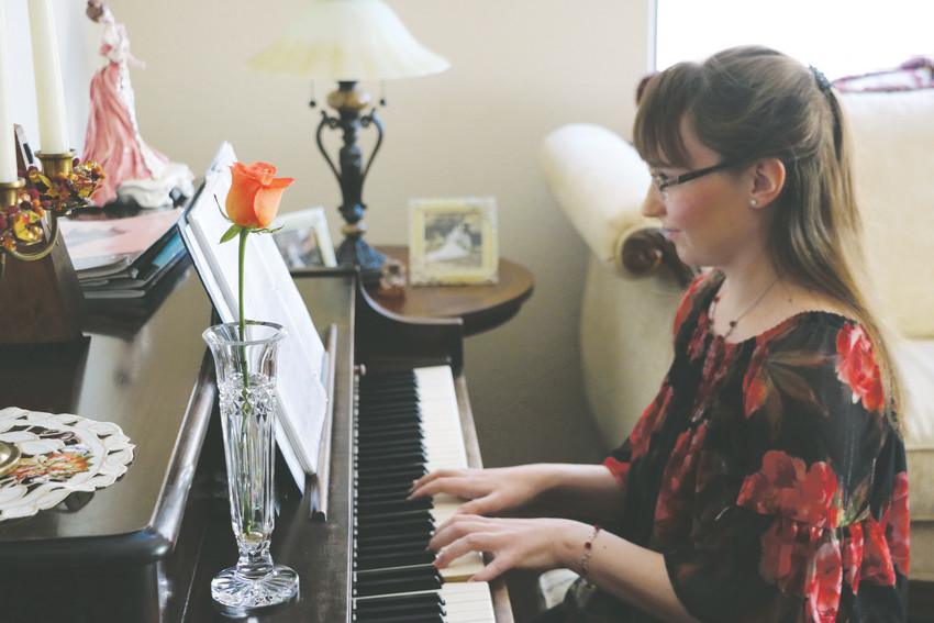 Emily Rose Abruzzo learned how to play the piano when she was 8 years old. The now 18-year-old has a lengthy resume — she's played at malls, nursing homes, a wedding and other venues. Her signature piece, a single rose in a glass vase, travels with her wherever she plays.