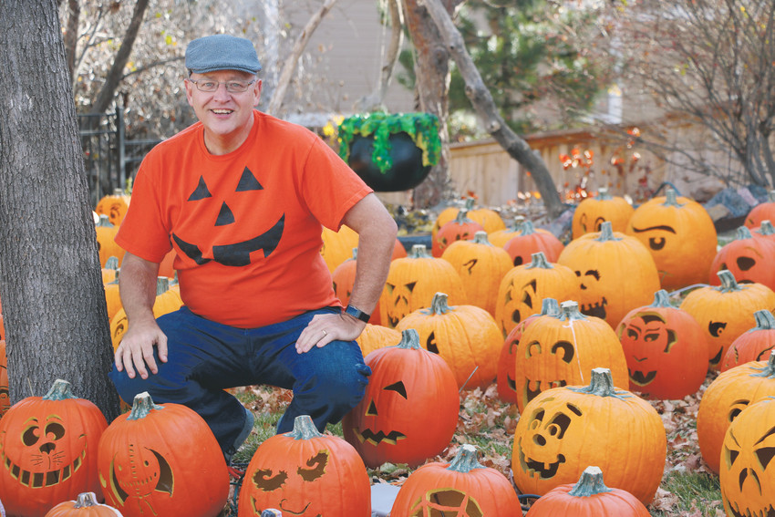 "Jim Christopherson stands in his front yard, where 250 pumpkins come to life for the community on Friday and Saturday nights in October. ""It creates an ambience,"" he said, ""more than a fear."""