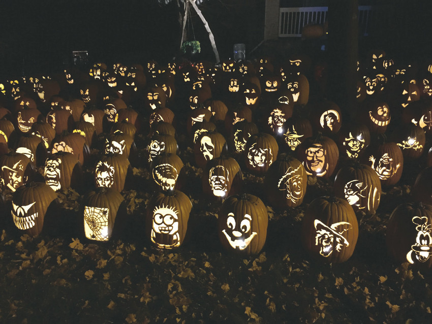 More than 500 community members gather at the Christopersons' home on Gray Fox Court, near South University and Quebec, on Friday and Saturday nights in October for a one-of-a-kind pumpkin show.