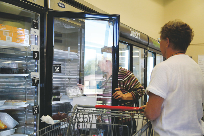 The choice store at the Arvada Community Food Bank runs on a point system that allows residents to pick fresh produce and meats in addition to canned foods.