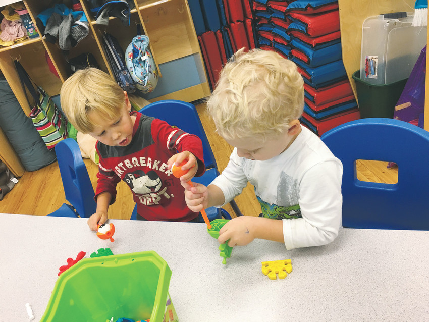 Logan B., left, Jax L., both 3 years old, play with K'NEX building blocks at a toy testing day in late September at The Goddard School, 14679 W 87th Pkwy., in Arvada. The children will vote on their favorite preschooler-approved toys and the winners will be announced Nov. 1.