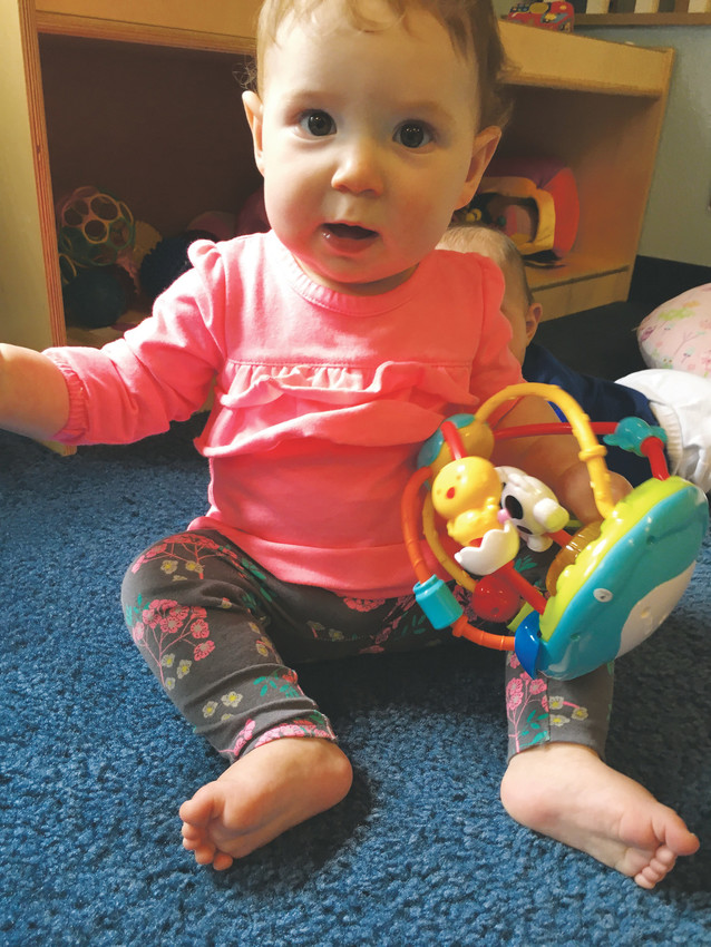 Hannah B., 10 months, plays with a wobble busy ball at a toy testing day in September at The Goddard School, 14679 W 87th Pkwy., in Arvada. Teachers observed and documented the toys based on several criteria, including interactivity, skill development and creative inspiration.