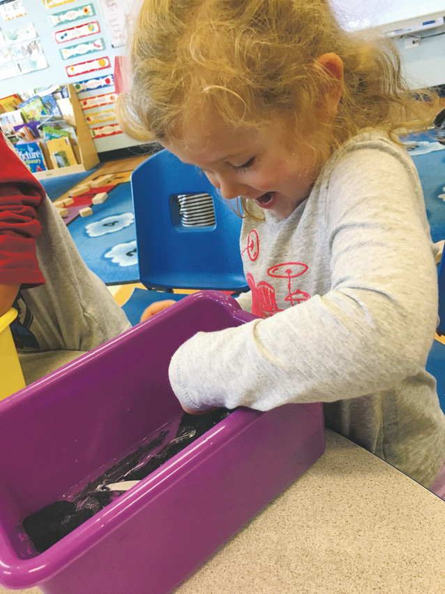 Eloise S., 4, plays with slick sand during the 2017 Goddard School Preschooler-Approved Toy Test, held in late September at The Goddard School, 14679 W 87th Pkwy., in Arvada. Children ages infant to 6 years old played with interactive toys while teachers observed and rated the toys on several criteria.