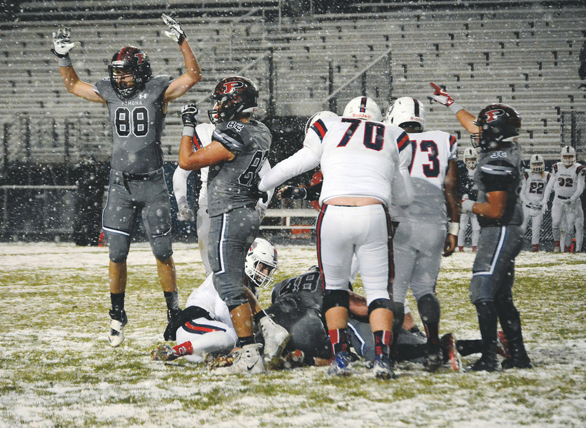 Pomona senior Tanner Kimminau (88) leads the celebration on one of three fumble recoveries in the first half for the Panthers' defense against Chaparral. Pomona had its best defensive effort of the season with a shutout victory against the Wolverines on a snow night at the North Area Athletic Complex on Oct. 26.