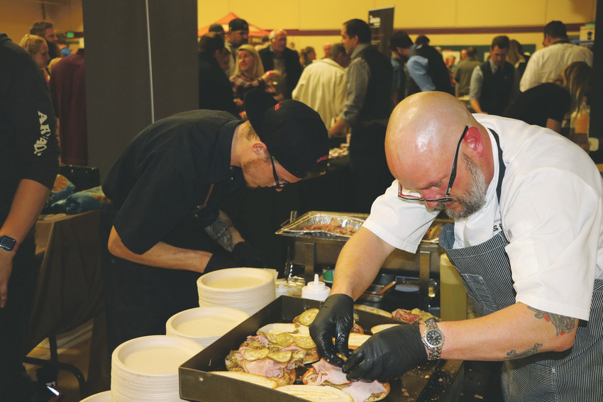 "Chefs from Steuben's restaurant in Arvada prepare Cuban sandwiches during the annual Taste of Arvada at the Apex Center on Oct. 26. ""Being about to be out with the community is so great,"" said Andrew Dahler, general manager of Kline's Beer Hall. ""It's a chance to put ourselves out there with the people."""
