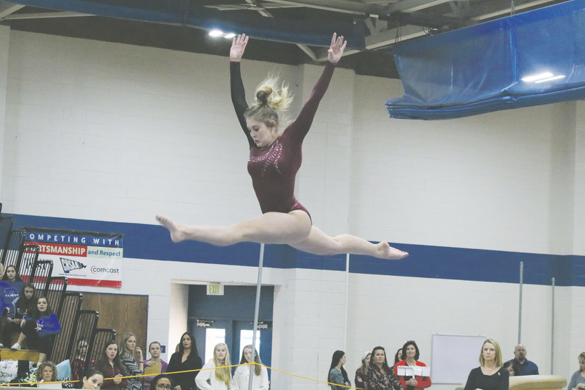 Ponderosa's Katherine Compton competes on the balance beam during the Nov. 4 state individual gymnastics event championship meet held at Thornton High School. She finished sixth in the event but she won the floor exercise championship and she was third in vault.