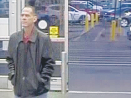 Police claim Scott Ostrem is shown in this photograph, entering the Thornton Walmart Nov. 1 just before he took a handgun out of his pocket and opened fire, killing three.