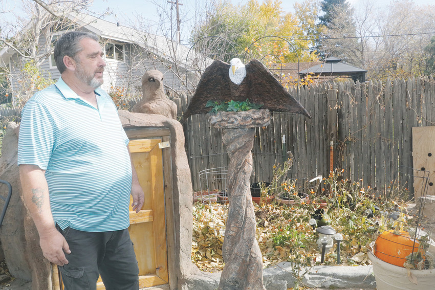 Rick Beavers talks about the eagle lamp he entered in the Englewood Art Show. The Englewood resident sculpted the entire lamp out of cement and painted it to fit the theme of the project.