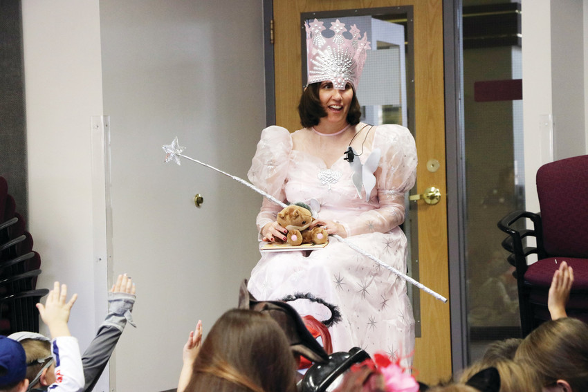 "Douglas County School District Interim Superintendent Erin Kane reads to elementary school students at HalloWilcox, the first trick-or-treat event on Oct. 31 at the district's administrative building in Castle Rock. ""It's all about the kids,"" Kane said."