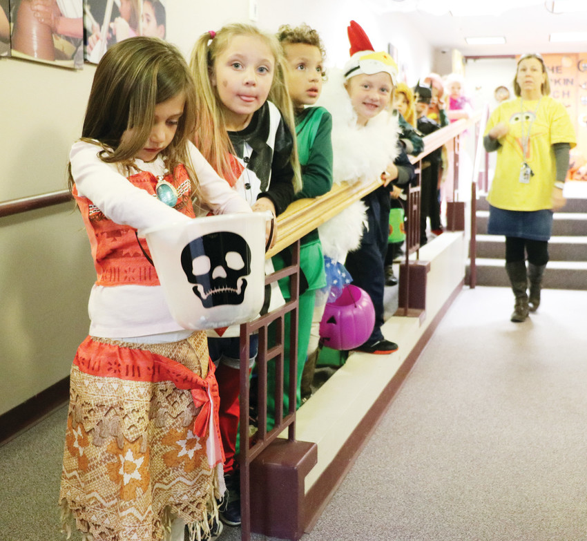 Douglas County elementary school students lined up for candy at the first-ever HalloWilcox, a trick-or-treat event on Halloween at the school district's administrative building, 620 Wilcox Street, in Castle Rock.