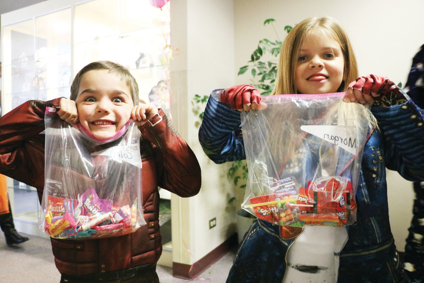 "Cole Edwards, left, and Morgan Miller are beaming with excitement at HalloWilcox, a trick-or-treat event at Douglas County School District's administrative building, 620 Wilcox Street, in Castle Rock. ""My favorite part is the candy,"" said Miller, adding that his favorite kind is Nerds."