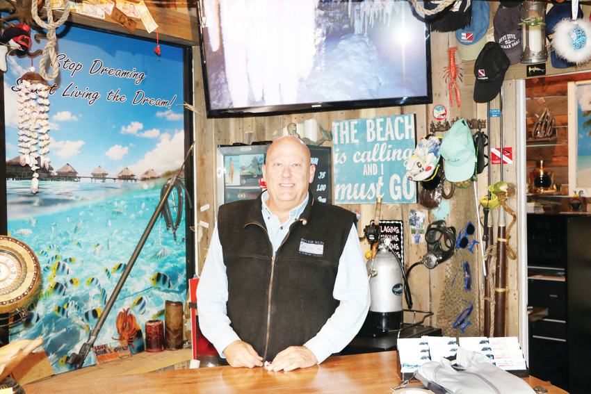 Fred Halcomb, owner of Arvada's Coral Key Scuba and Travel shop, was first certified when he was 10 years old, and went on to join the Navy.