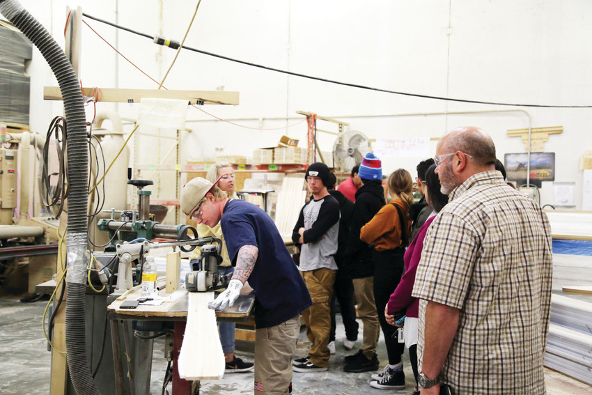 Warren Tech learned about the snowboard building process on their tour at Never Summer.