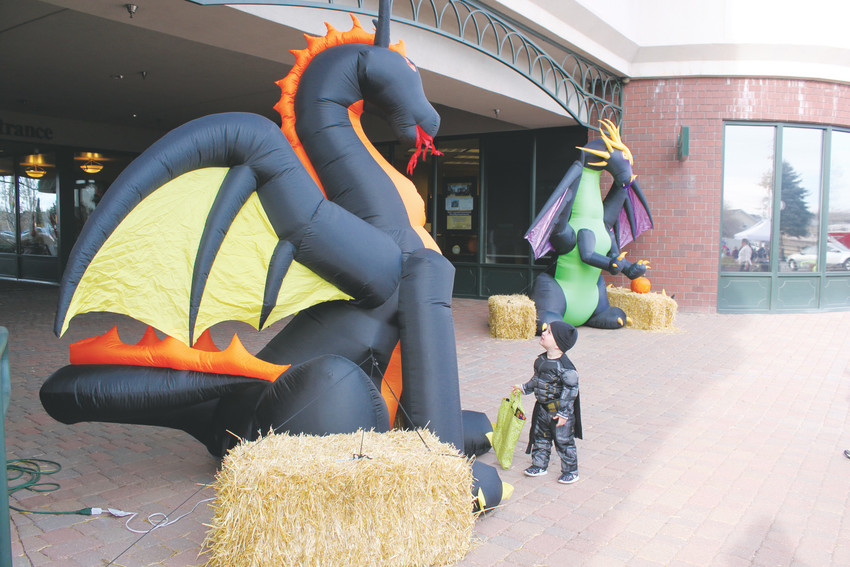 Brody Muldoton, 2, was not afraid of the menacing 8-foot dragon on Mainstreet.