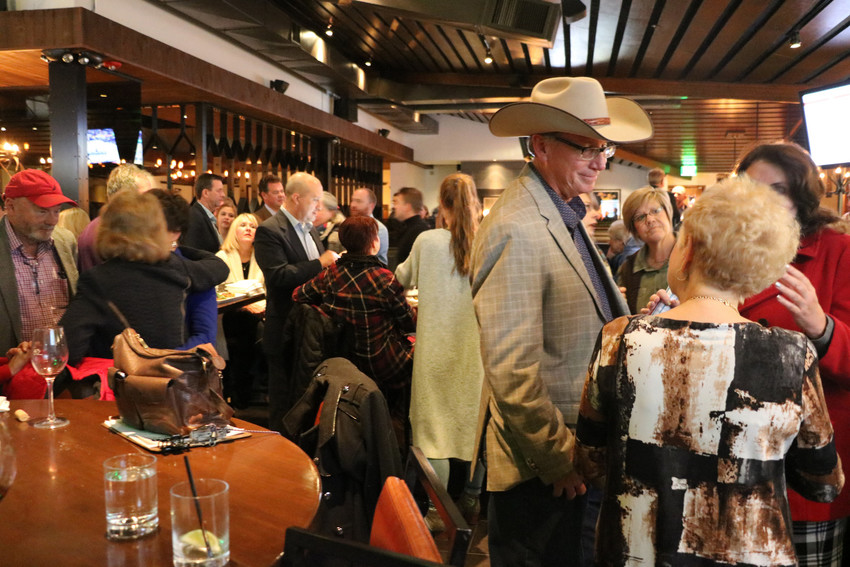 Randy Mills, wearing the hat, talks to fellow Elevate Douglas County candidate Debora Scheffel at a viewing party on Nov. 7 at Earl's at Park Meadows in Lone Tree.  Photo by Alex Dewind