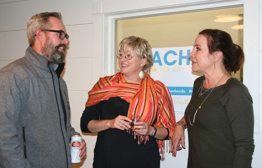 From left, Wheat Ridge resident Jason McCullough, Wheat Ridge city council candidate for District 2 Rachel Hultin and Hultin's campaign manager Kristine Disney hold a conversation during Hultin's watch party Nov. 7 at the Post Oak Hall in Wheat Ridge.