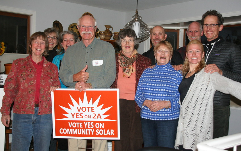 Supporters of Golden's solar ballot issue celebrate during a watch party on Nov. 7 at a private residence. Jim Dale, who ran unopposed for Ward 3 is in front, holding the sign. As of 10:24 on election night, the ballot issue passed among Golden voters by 81 percent.