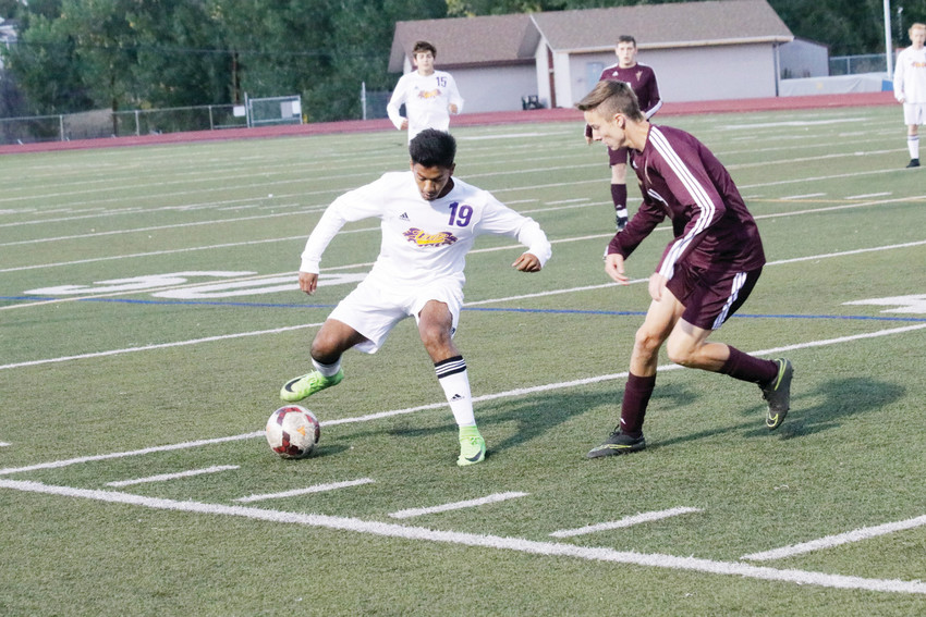 Rubin Cervantes, 19, gains control of a loose ball during a September league soccer game against Golden. Defense was a team strength for the Lions this season and they defeated Golden 1-0. It was one of six shutouts during the season and Littleton only gave up 11 goals in 18 games.
