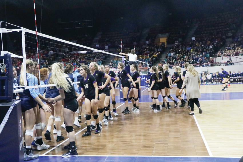Holy Family players congratulatie the Valor Christian players after the Eagles won the Nov. 11 Class 4A semifinal game during the state championship volleyball tournament played at the Denver Coliseum. Holy Family was league champion with a 14-0 record and finished the regular season and state tournament with a 25-3 mark.
