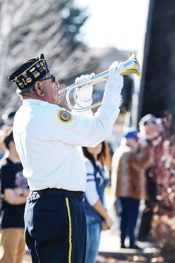American Legion Post #22 Commander Joe Vargas, bugles taps near the end of Veterans Day ceremonies at the Northglenn Veterans Memorial.