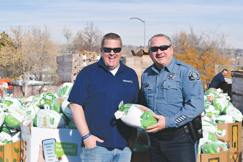 Adams County Sheriff Michael McInstosh hold a turkey alongside Adam McIntyre, store manager of the Walmart in Brighton, at the 2016 Operation Freebird. The county and partners like Walmart gave away makings for a Thankgiving dinner to 3,000 families last year. As many as 15,000 people are expected to attend the event this year.